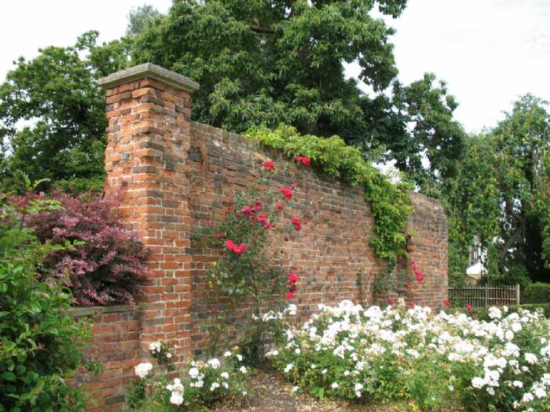Priory Gardens Orpington, brick wall and roses