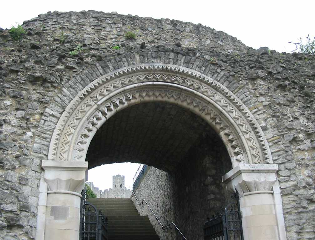 Ornate stone arch leading to castle
